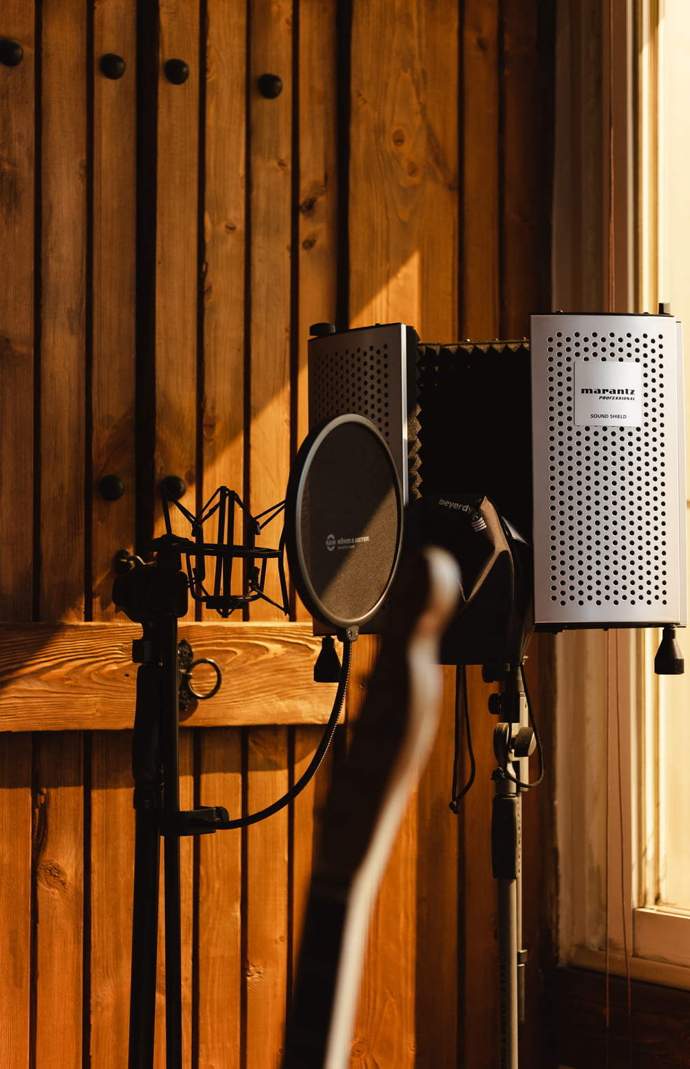 black and gray microphone on stand