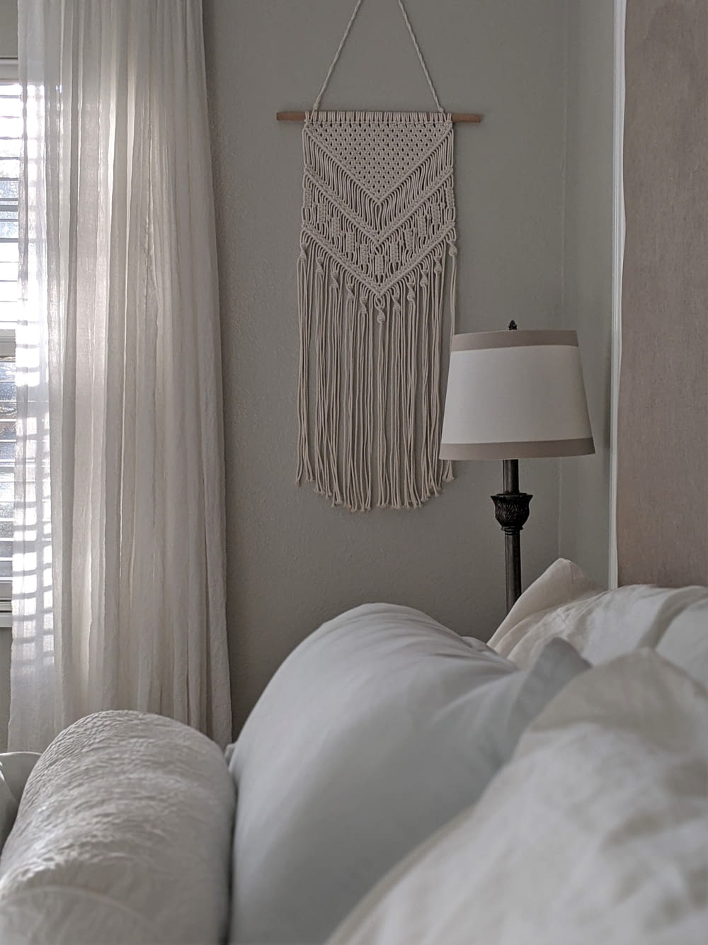 white and black table lamp beside white window curtain
