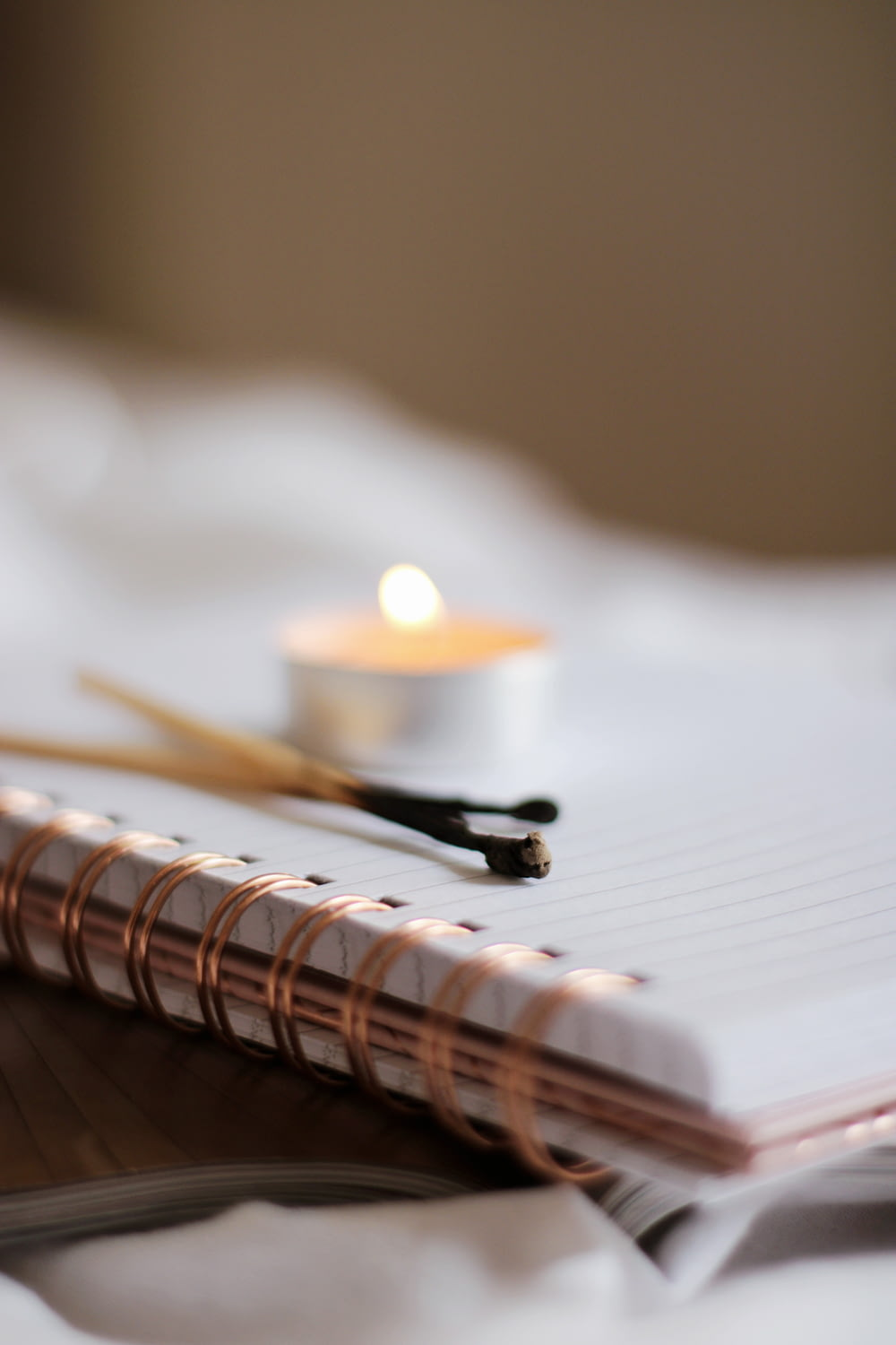 white candle on white paper