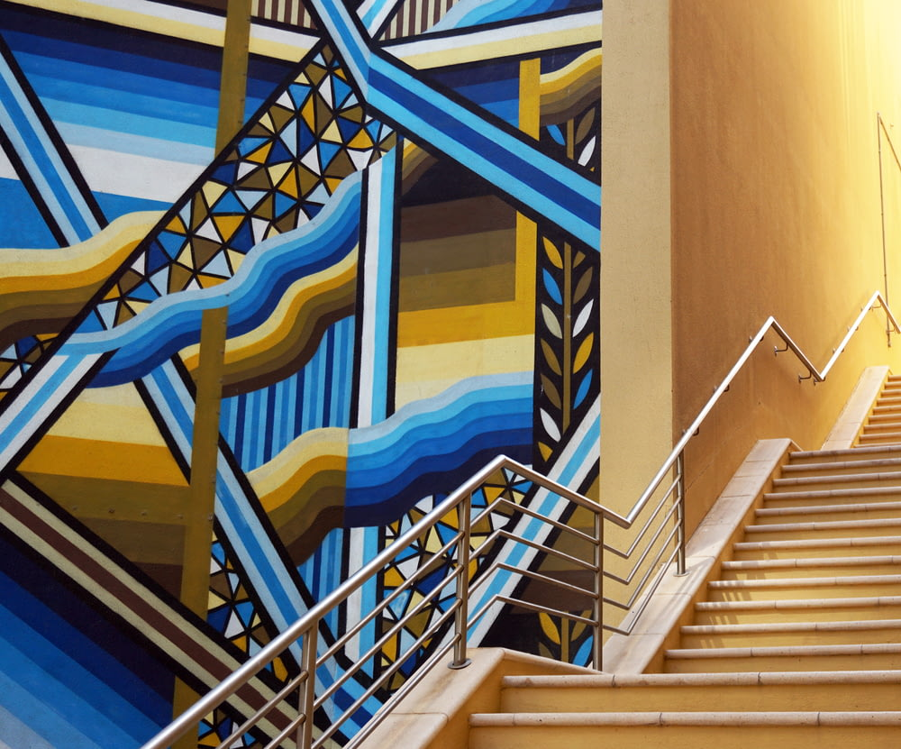 blue white and yellow concrete staircase