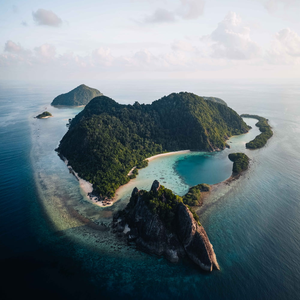 green island in the middle of ocean
