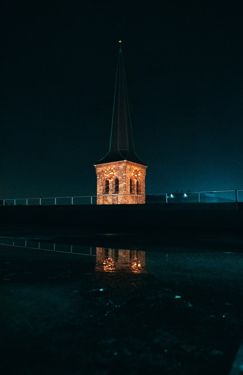 brown concrete building near body of water during night time