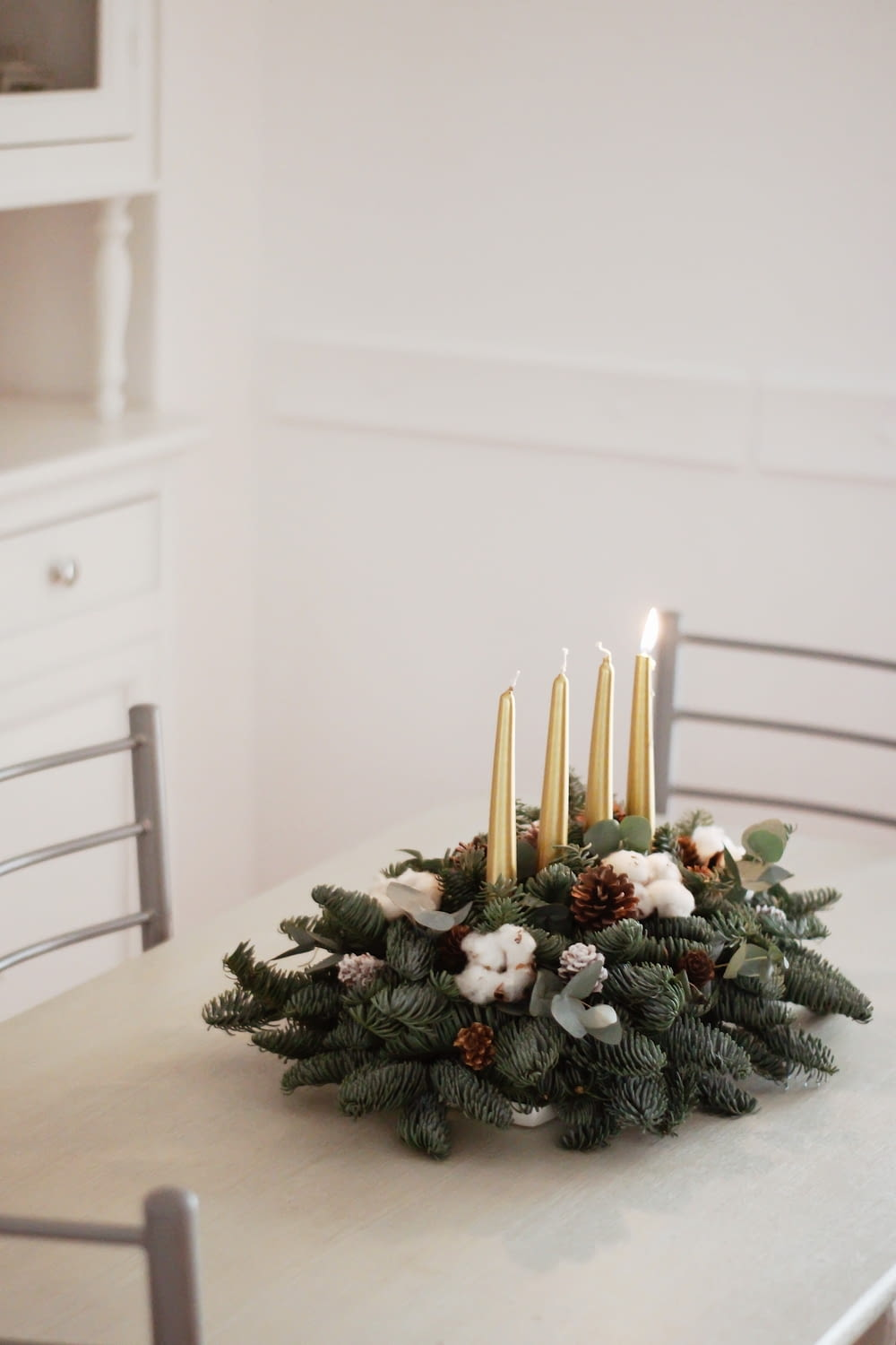 green christmas tree with white candles