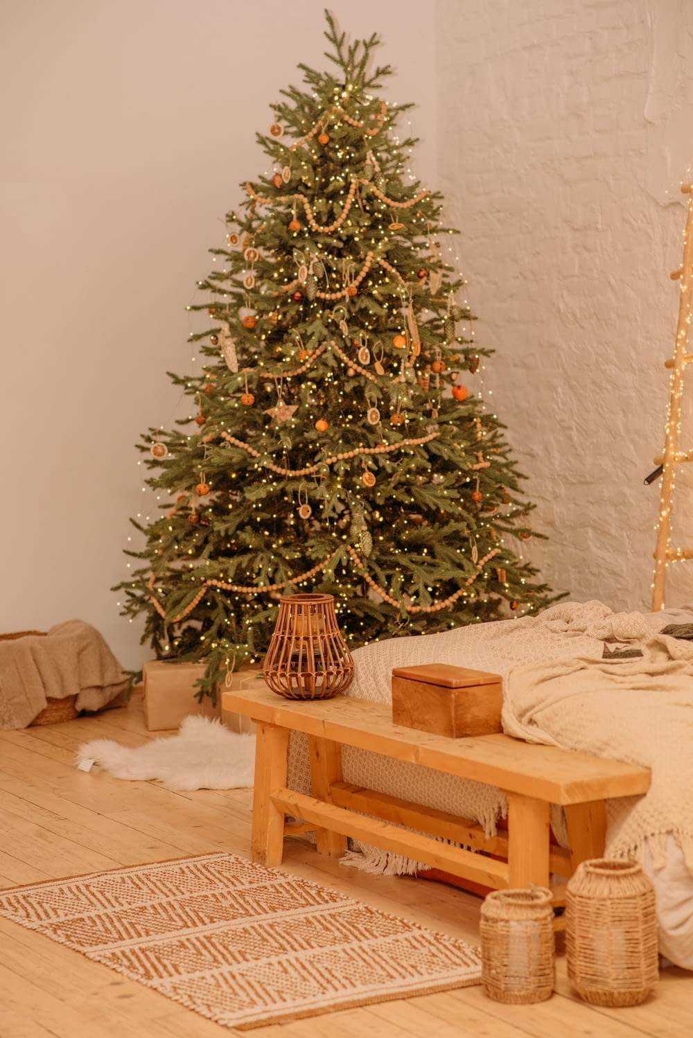 green christmas tree on brown wooden table
