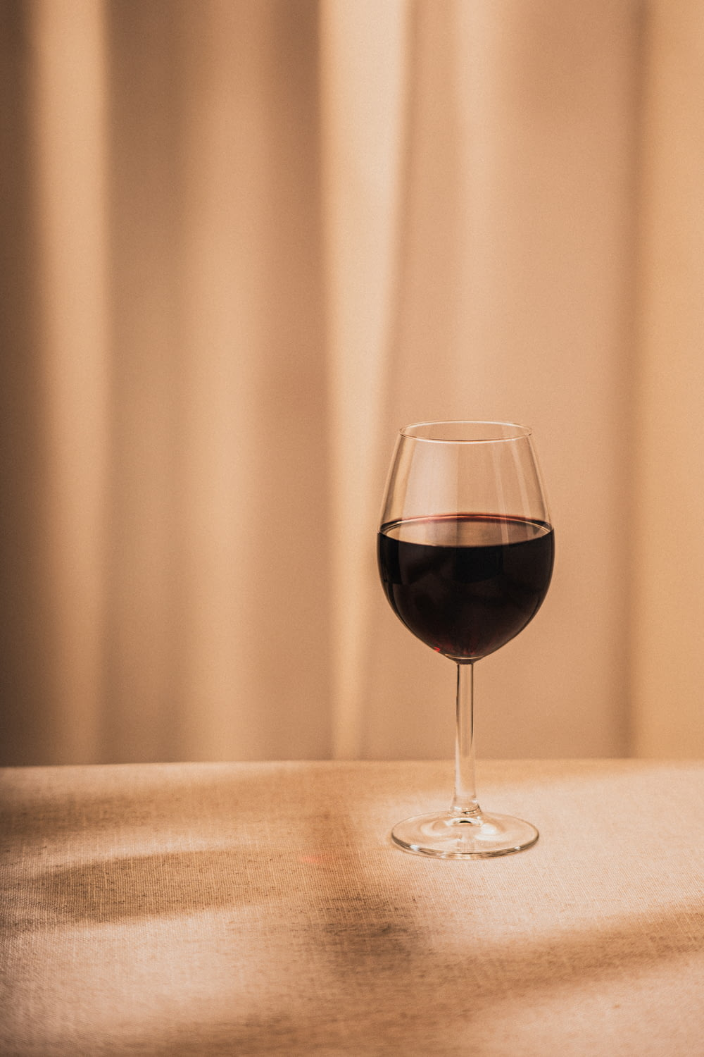 clear wine glass with red wine