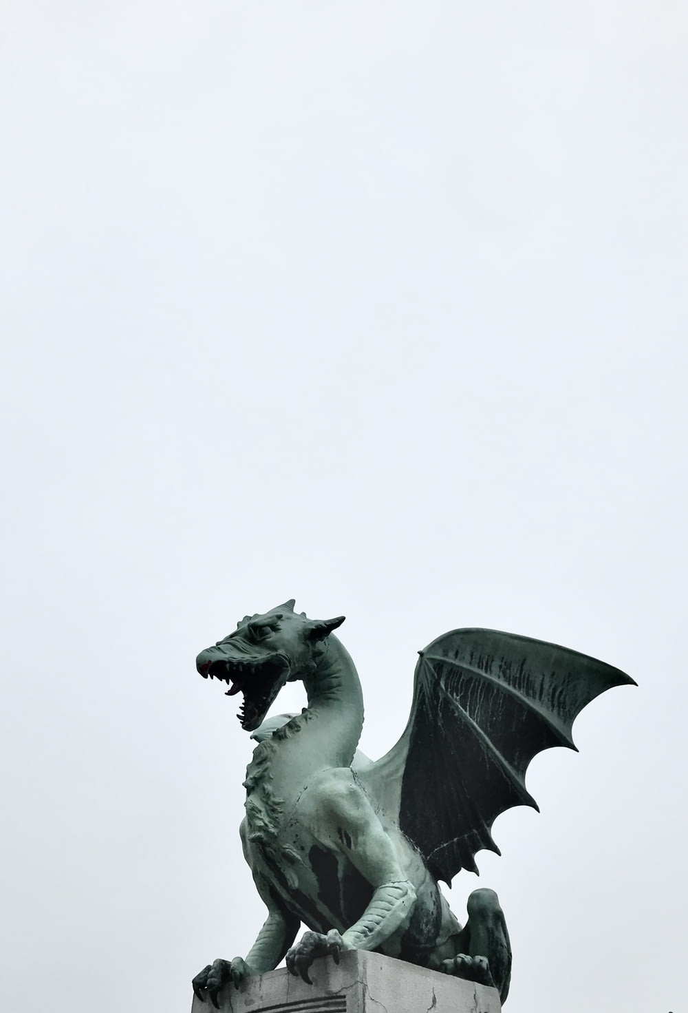 white horse statue in close up photography