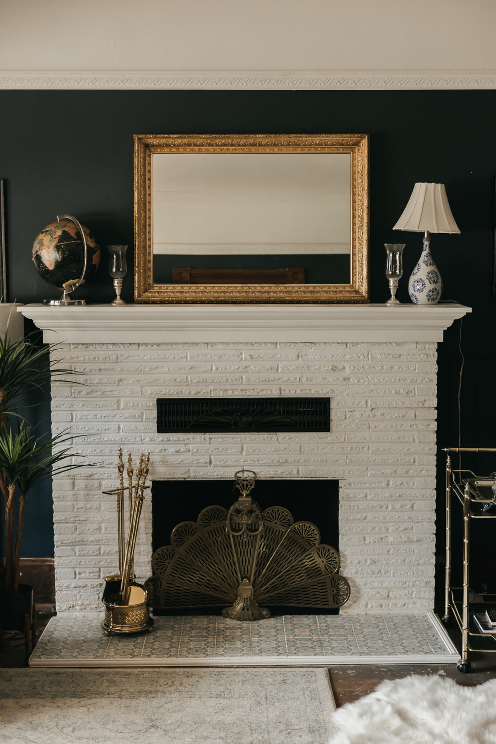 white and gold fireplace with brown wooden frame