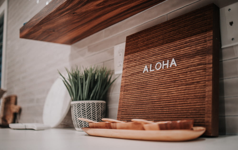 brown wooden board on white table