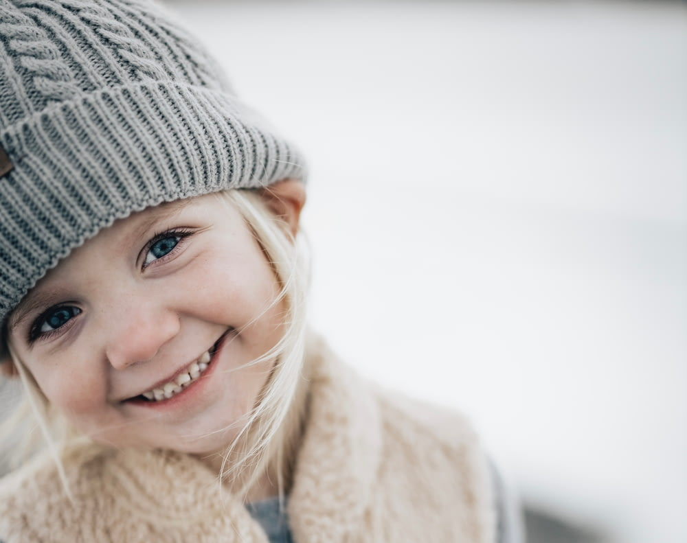 smiling girl in gray knit cap