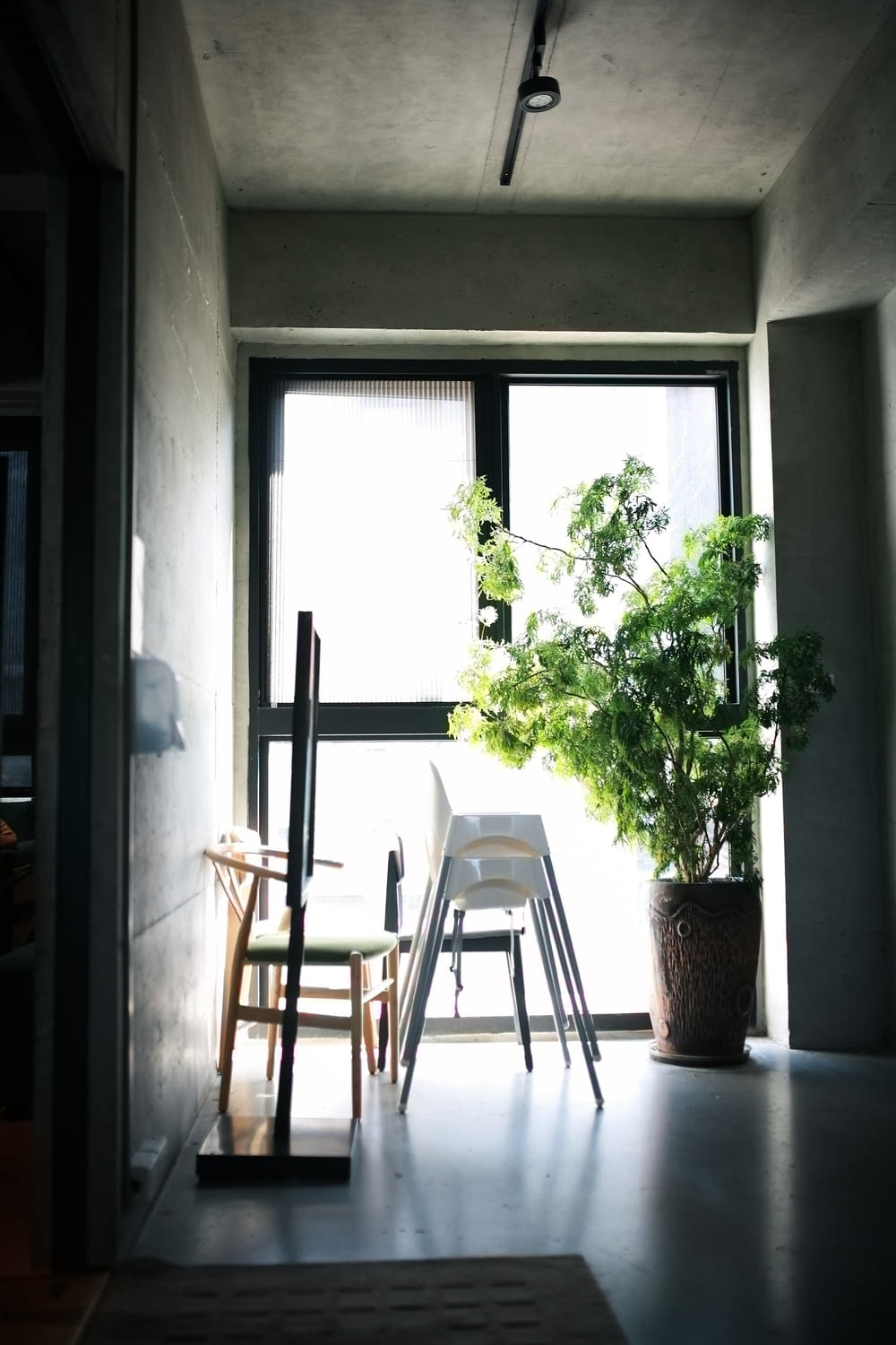 white wooden chair beside window