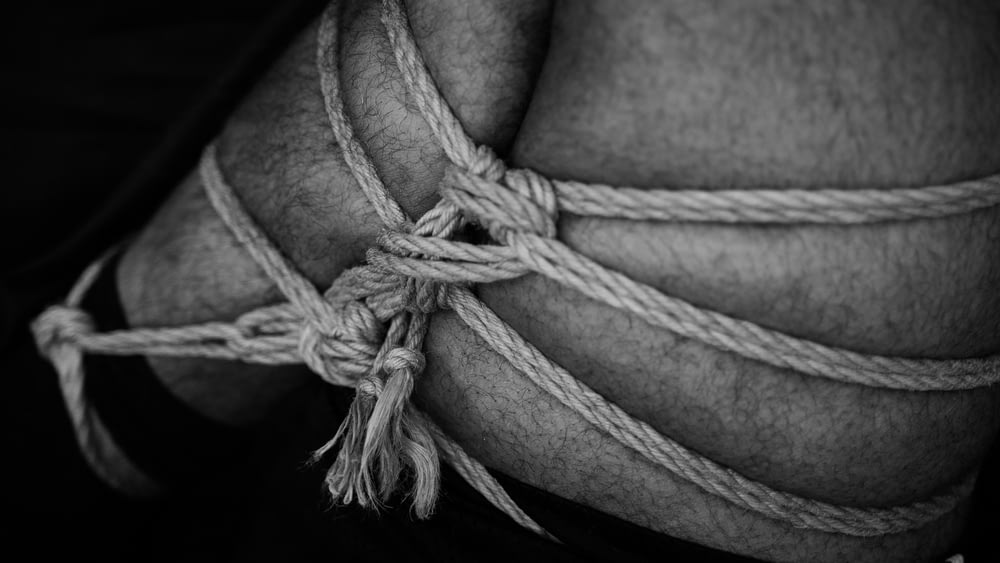 grayscale photo of rope tied on rope