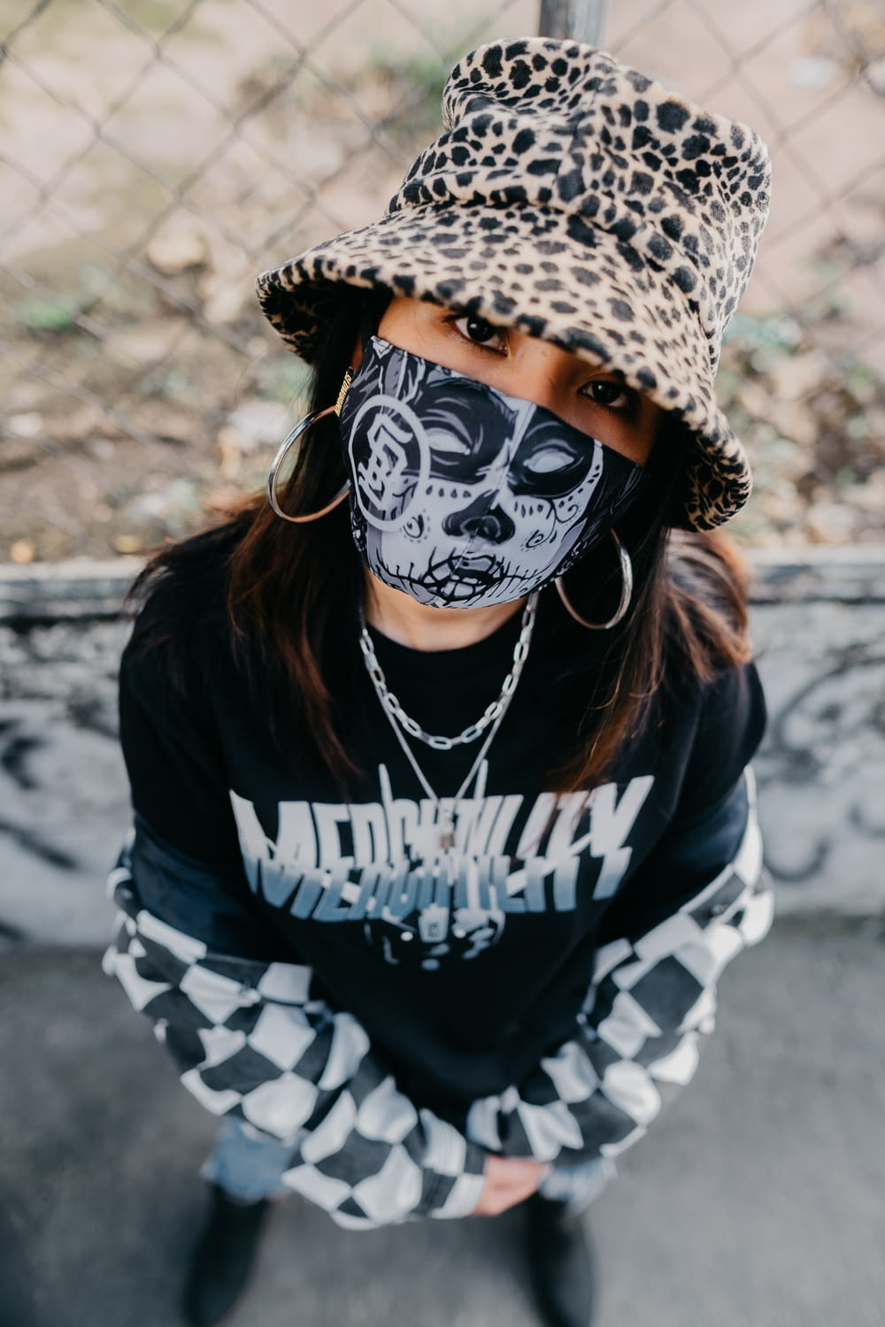 person wearing black and white skull mask