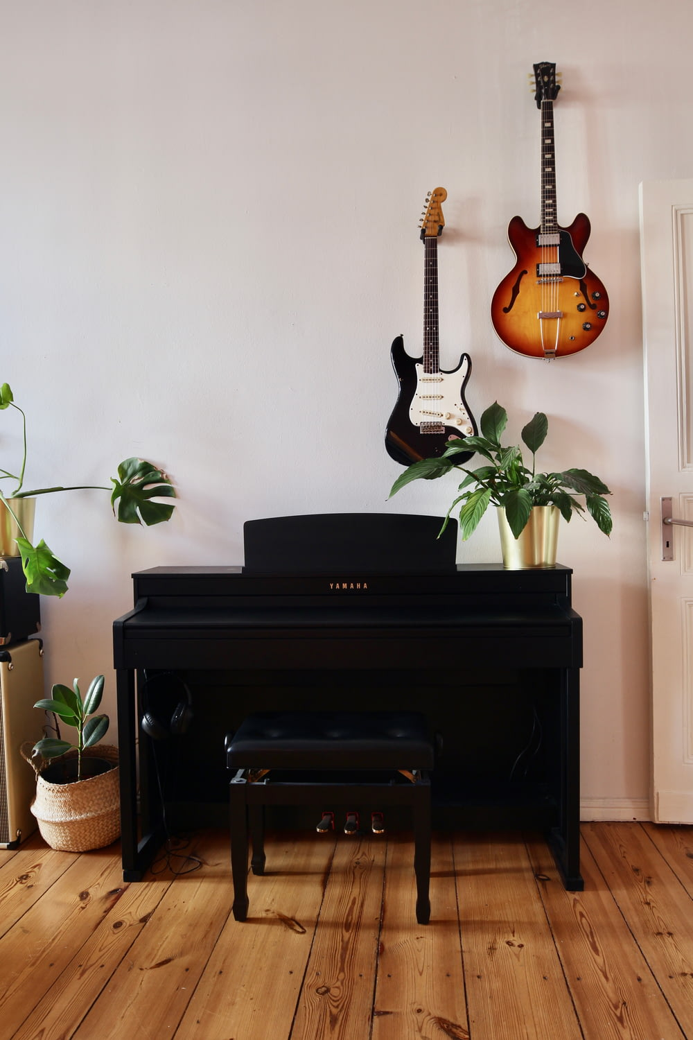 brown and black electric guitar on black guitar stand
