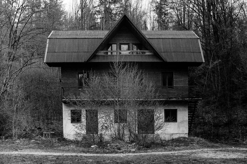 grayscale photo of brick house