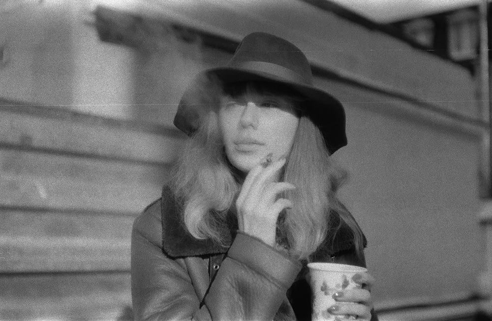 woman in black hat and coat