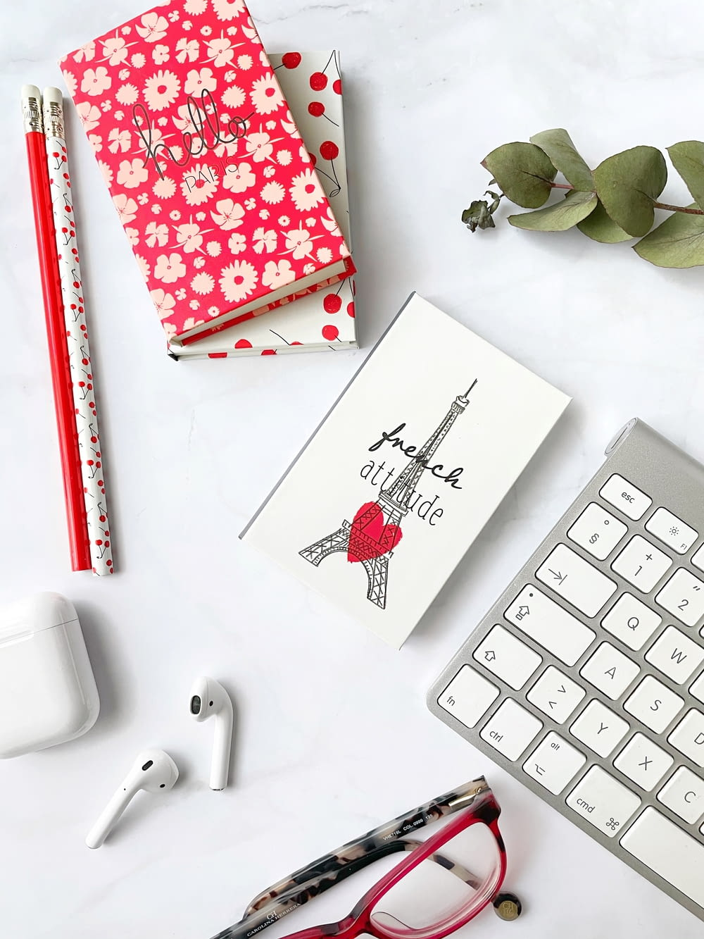 white and red heart card beside white computer keyboard