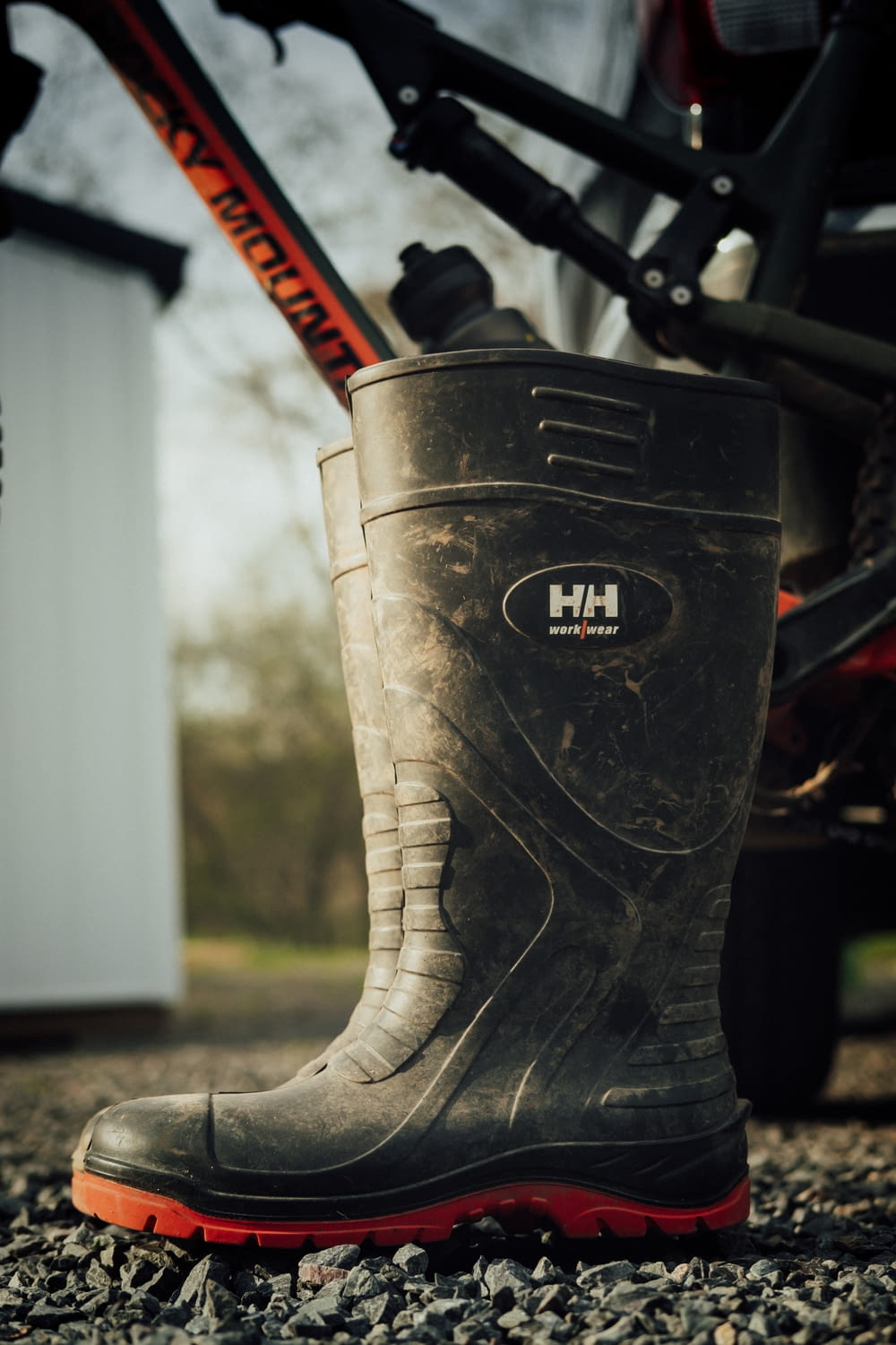black leather boots on brown dirt