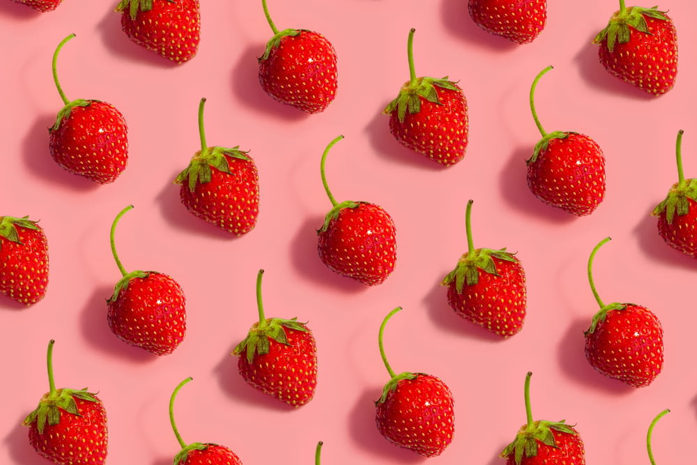 red strawberries on white background