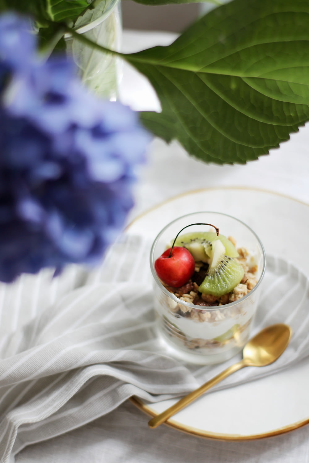 clear glass cup with ice cream and cherry on top