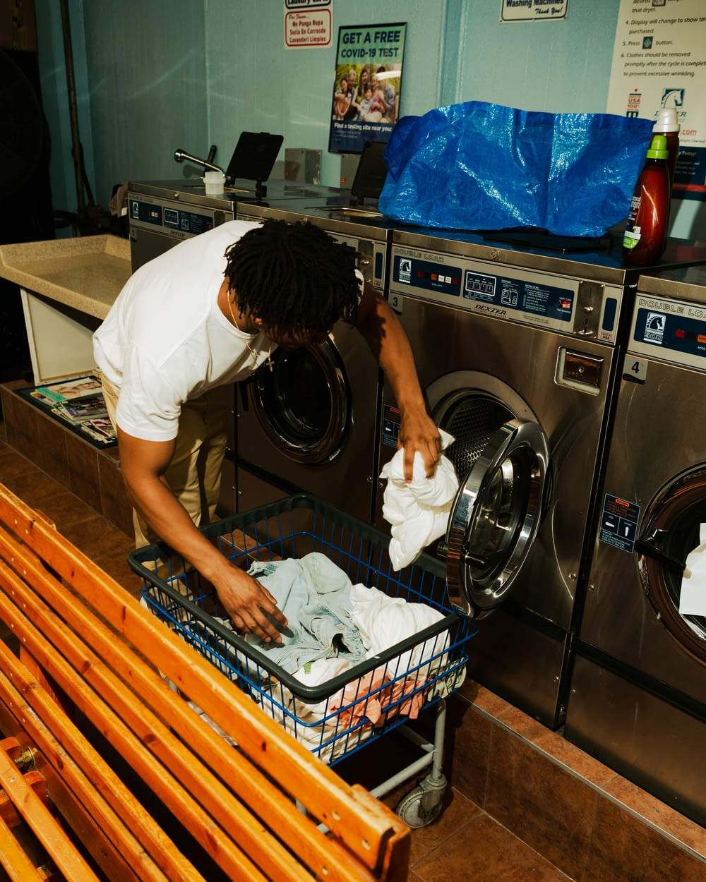 woman in white t-shirt washing dishes