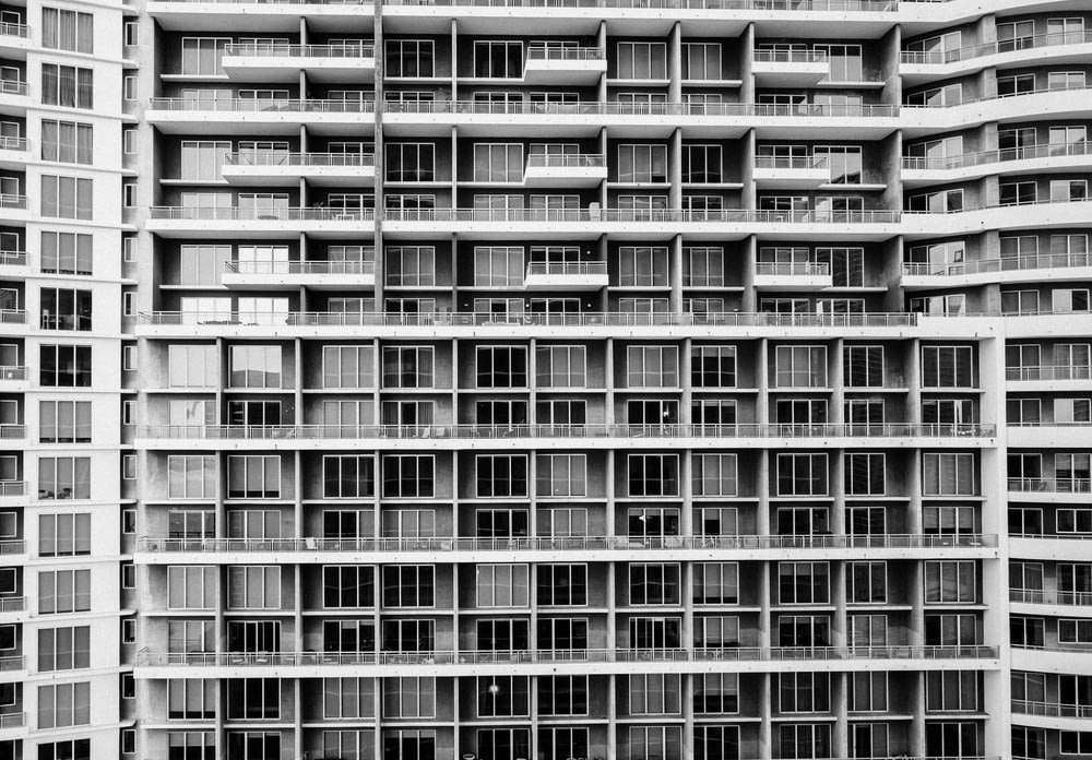 grey scale photo of a building