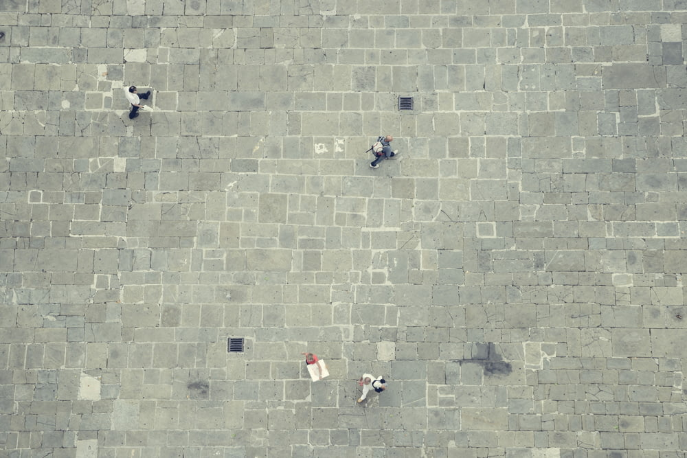four walking people in top view photography